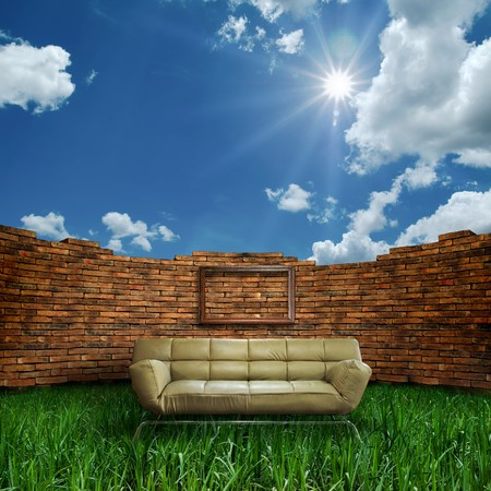 light brown color sofa in open brick wall room photo