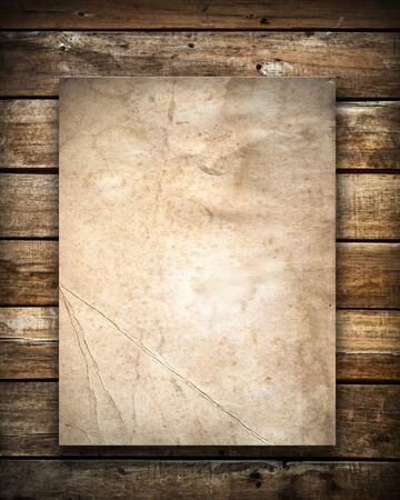 old wood: Grunge paper on old wood wall Stock Photo
