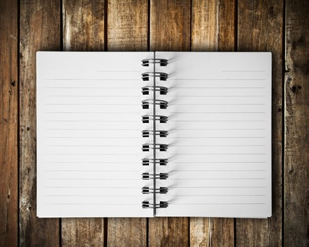 notepad notes object: Open blank note book on grunge wood Stock Photo