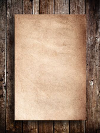 Old brown paper on wood panel photo