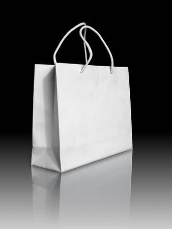 white paper bag: Bolsa de papel blanco en reflejar el piso y fondo negro
