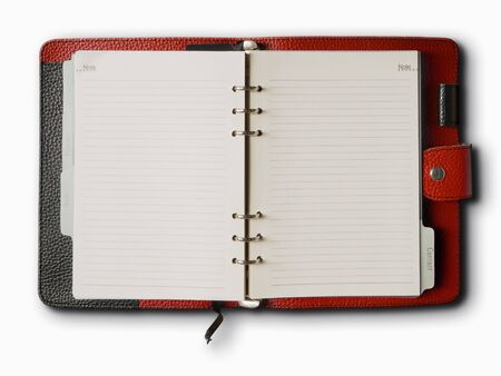 organizer page: Black and red leather cover of binder notebook Stock Photo