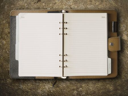 Black and brown leather cover of binder notebook on stone Stock Photo - 8042413