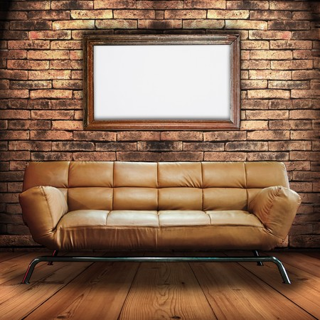Leather Sofa on Wood Floor and Wood frame Sign in Brick Wall Room Stock Photo