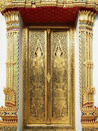Thai art gold painting on church wood door Bangkok Thailand Stock Photo - 8042422