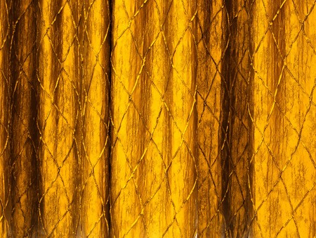 Texture of Gold curtains on a stage background photo