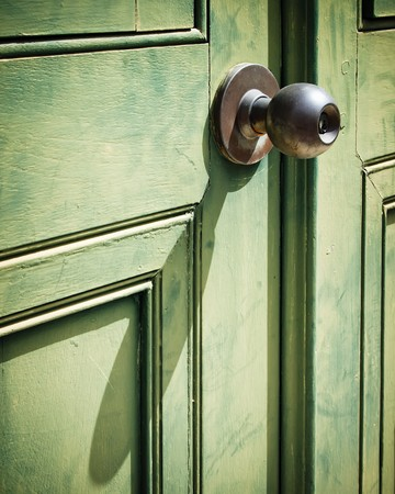 Old iron doorknob on old Green wood door Stock Photo - 8042439
