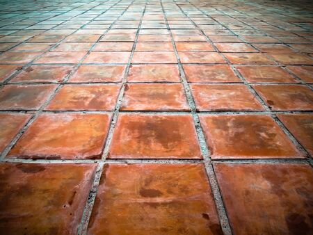 Perspective of Square red tiles floor photo