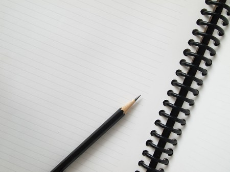 Black pencil on open white paper note book top view Stock Photo - 8174265