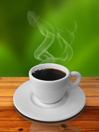 White cup of hot coffee on wood table and green background