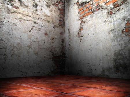 Corner room of the cracks of the brick walls cement plaster red floor Stock Photo
