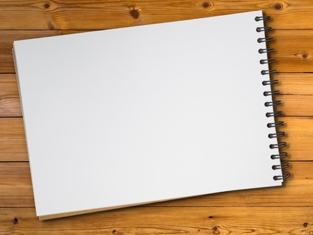 note book: White blank page sketch book on wood table
