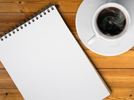 White cup of hot coffee and white sketch book on wood table Stock Photo - 8255198