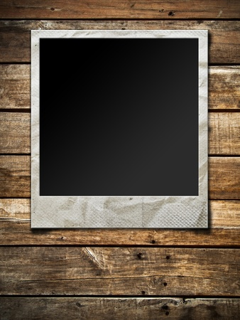 Old Polaroid photo frame on wood background photo
