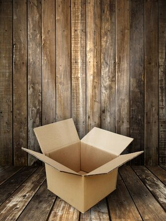 Brown paper box open in Grunge wooden panel and floor room background Stock Photo - 8324548