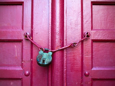 Old Lock Green Key on Close Red Wood Door photo