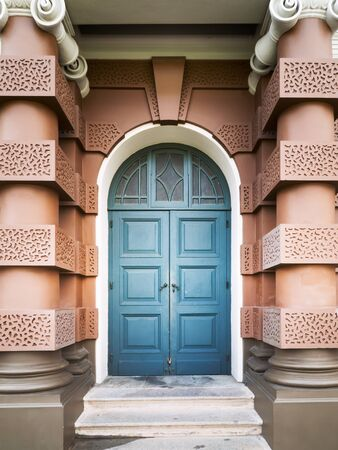 view of a wooden doorway: Royal blue entrance door European style Stock Photo