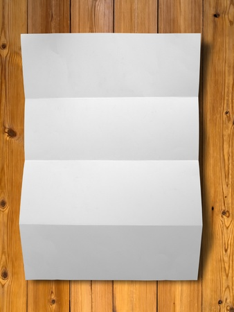 Empty white Crumpled paper on wood table vertical photo