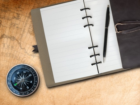 Black pen with Brown Leather cover note book and Compass on old map background Stock Photo - 8433933