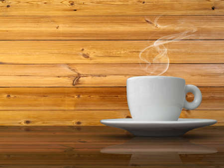 A white cup of coffee on wood table and wood wall background photo