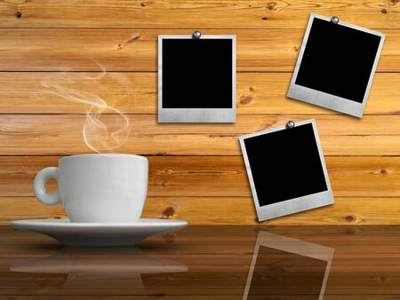 hot frame: White cup of hot coffee on table and old paper photo frame on wood wall
