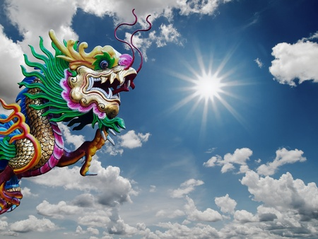 Chinese Dragon statue and sunny sky background photo