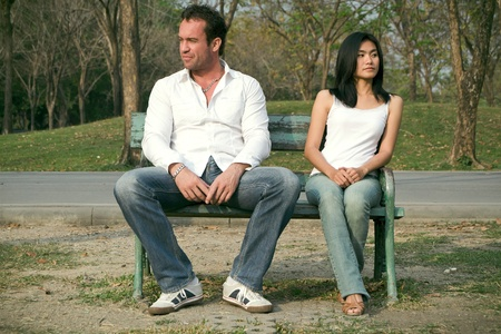 longer: Man and woman sitting on a chair and are no longer satisfied with each other