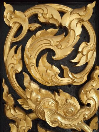 Wood carvings is a form of Thai art and painted black paint over the designs with gold Stock Photo - 8753907