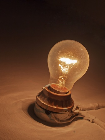 Traditional light bulb on wall