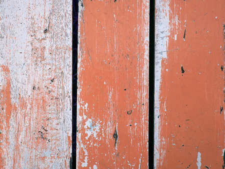 Surface of old wood Paint over with white and orange photo