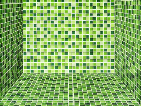 Wall and floor laid with bright green ceramic tile photo