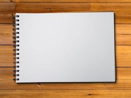 White blank pge sketch book on wood table horizontal