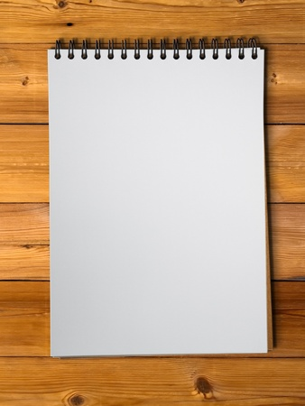 White blank pge sketch book on wood table vertical photo