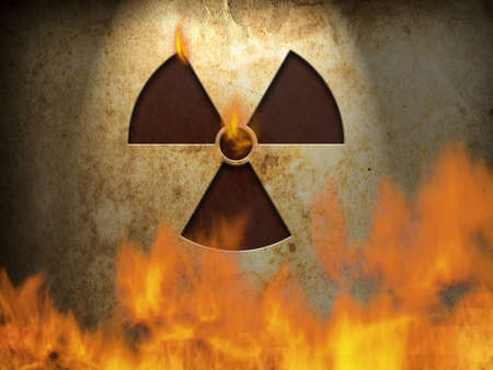 Nuclear symbol on wall with fire photo