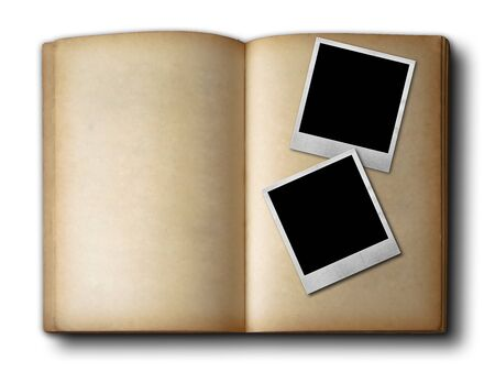 Two photo frames on old open book on white background