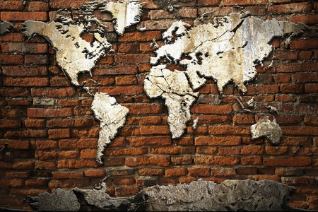 brick earth: Grunge concrete world map on old brick wall Stock Photo