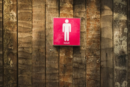Men toilet sign on nature wood wall photo