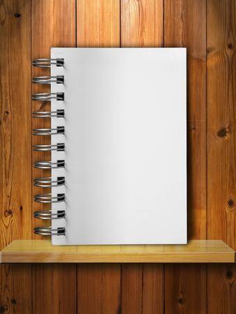 Blank White Note Book on Wood Shelf Stock Photo - 9296825