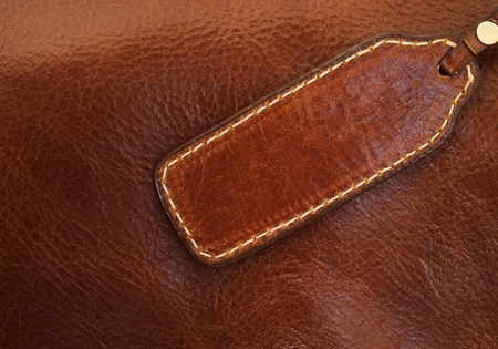 Banner made ​​of brown leather stitching gold thread Stock Photo - 9393827