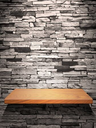 Wood shelf on stone wall with down light photo