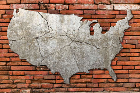 cracking: Cement cracking image United State map on Red brick wall