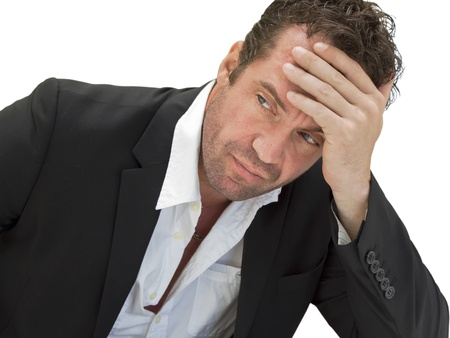 tiredness: Upset business man on white background Stock Photo