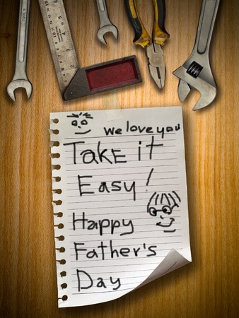 Father day note paper on wood wall and tools photo