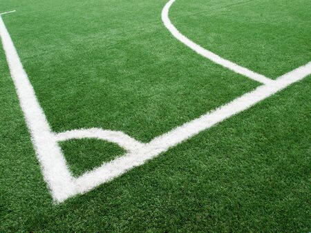 White line of the corner of soccer field Made of artificial grass