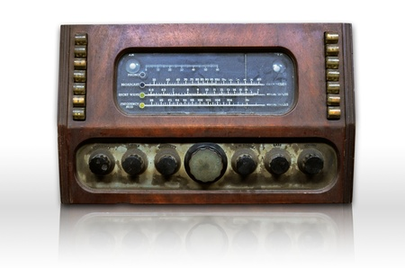 Dirty old radio on white and reflect photo