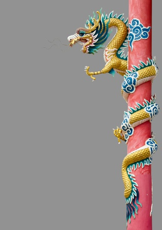 Golden Chinese Dragon Wrapped around red pole on Gray background photo