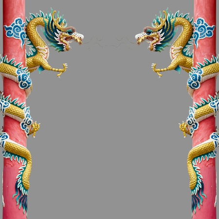 Twin Golden Chinese Dragon Wrapped around red pole on Gray background photo