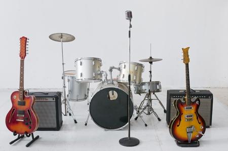 Group of musical instrument on white floor