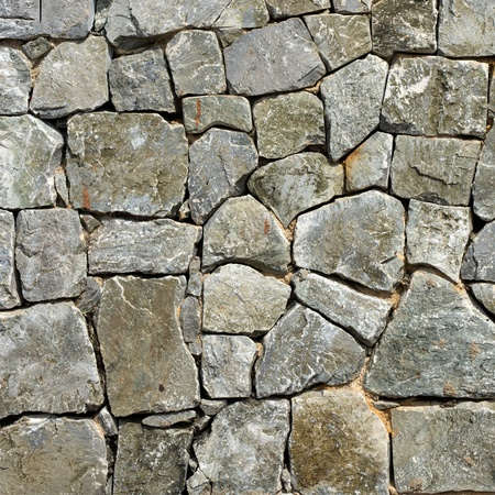 rock wall: Texture of old rock wall for background Stock Photo