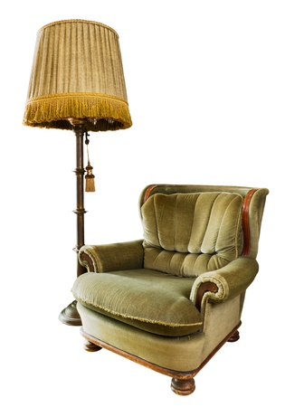 floor lamp: Old luxury armchair made from wood and fabric with floor lamp